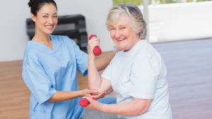 Elderly woman working with a physical therapist