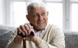Smiling Elderly Man With Cane